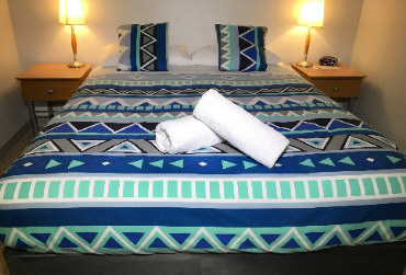 Double bed and bedspaed photo